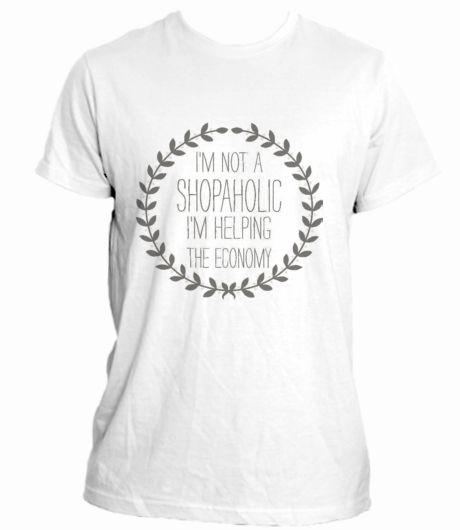 "Campaña en crowdence 'Help the economy, buy a shirt.': Camiseta blanca con estampado. ""I'm not a shopaholic I'm helping the economy"""