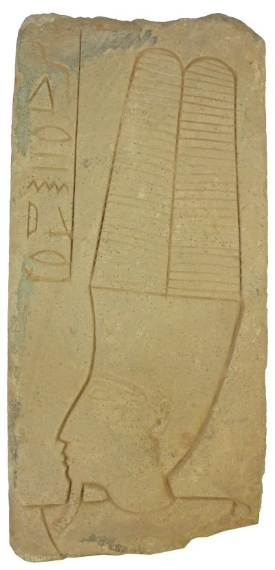 Egyptian Wall fragment :    Sandstone carving of the side profile of Amun, the Egyptian sky God who came to be regarded as a sun God and the head of the Egyptian pantheon, with a chin beard, headress, and cosmetic oulined eyes with one line of hieroglyphics at the top left surface. Light earthen patina. New Kingdom, 18th Dynasty.  1570 - 1342 BC