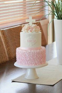 Pink and white buttercream tiered baptism cake