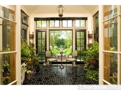 The orchid room is a glass lined transition to the outdoor for Transition windows for homes