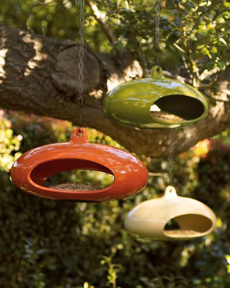 contemporary bird feeder from Neiman Marcus - vintage hanging ashtrays and candle holders from the 70s would work too, and be even cooler! -SM