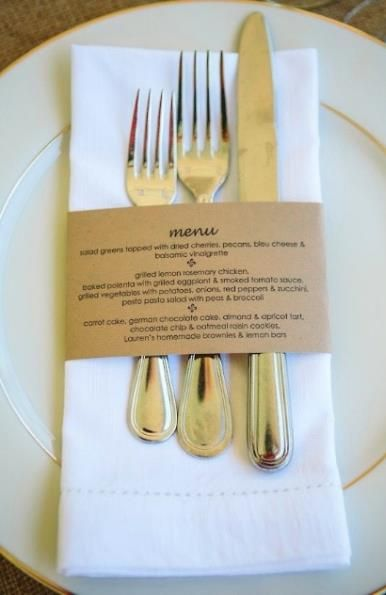 Menu printed on kraft paper strip and used as napkin and silverware holder.