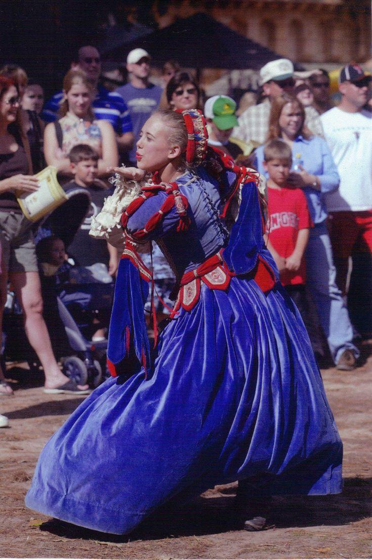 A flirty Boleyn maiden greets the crowds at the Texas Renaissance Festival,  open weekends October