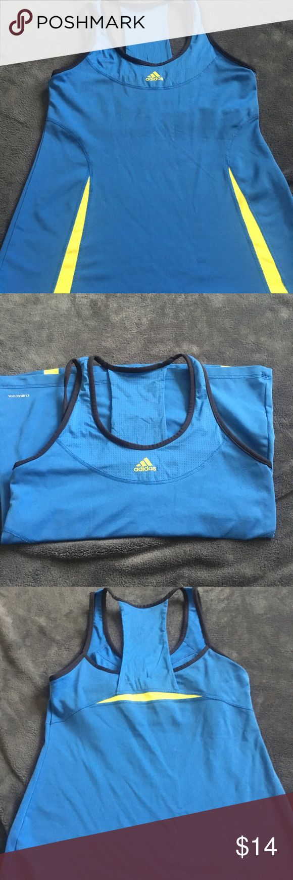 Adidas Clima workout too with built in sports bra. Blue Adidas Clima workout top. Has a built in bra. Perfect for running. Also pairs well with yoga pants for a casual day out. adidas Tops Tank Tops