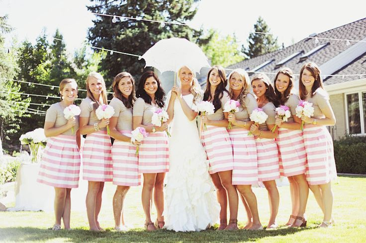 Striped bridesmaid dresses...wait not dresses, but skirts and neutral shorts...pretty cool idea for a summer wedding. Love the bride's dress too