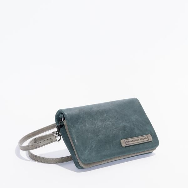 A versatile, Limited Edition leather women's bag/purse/clutch. Double sided and with an adjustable or removable strap and lined with high quality 100% cotton.