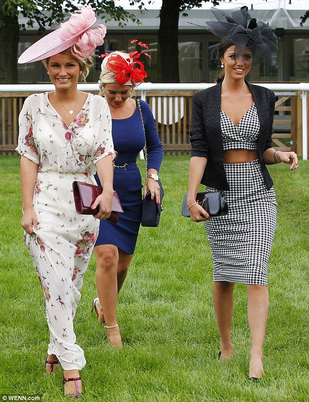 Pushing the boundaries: Lucy Mecklenburgh wears a cropped top and pencil skirt as she arrives at Newmarket racecourse with TOWIE co-stars Sam (left) and Billie (centre) Faiers