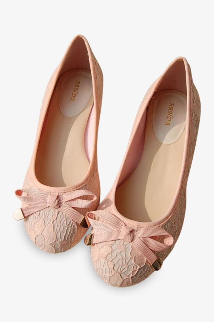 Add a feminine touch to any outfit with these pale pink ballet flats from  Randa. These flats feature extra padding inside to ...