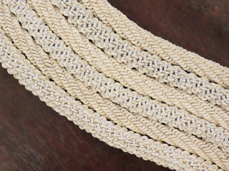 Ostrich eggshell and glass beads in rope necklaces, Namibia.