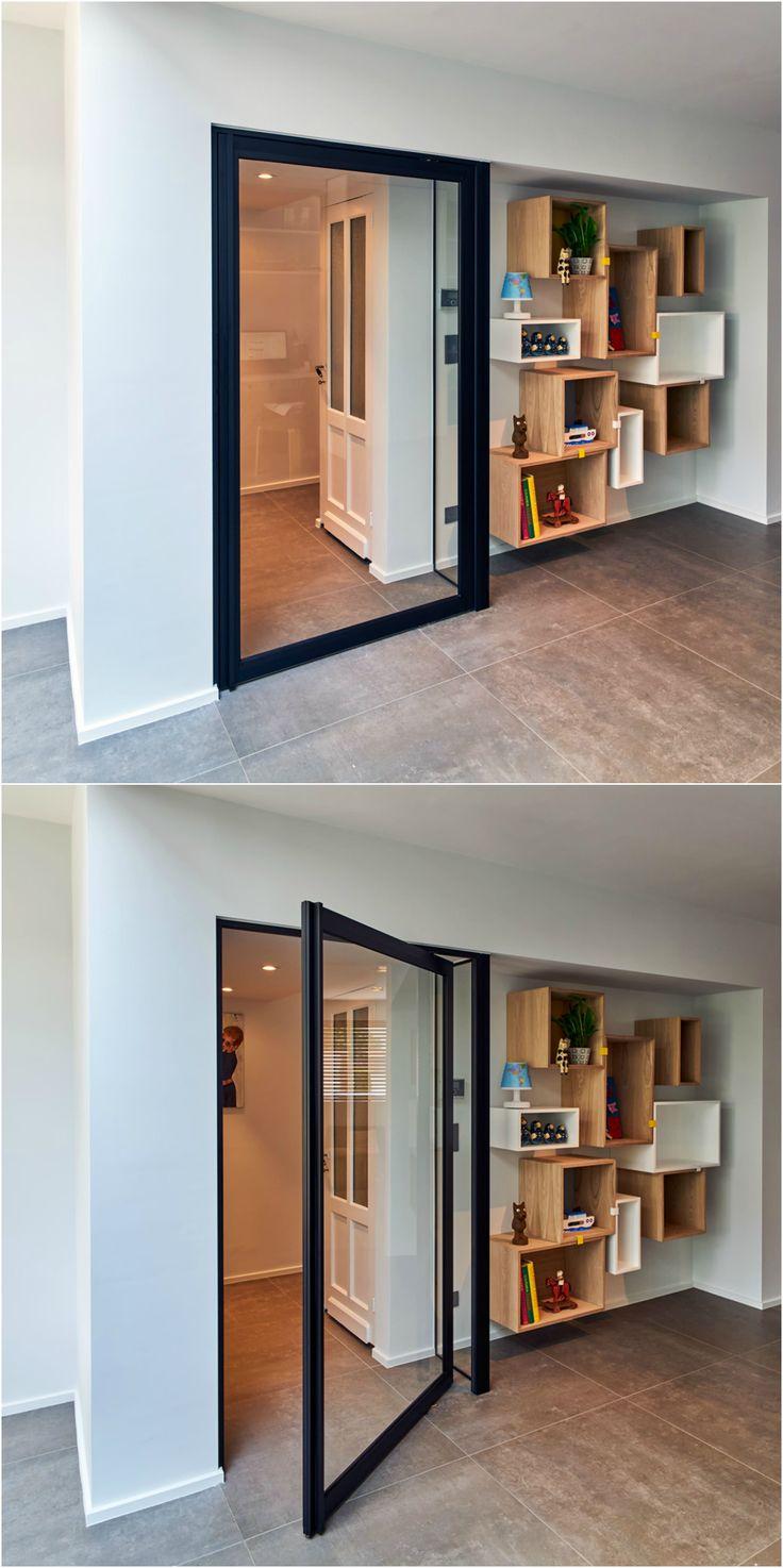 "Modern ""Steel look"" pivot door with offset axis pivoting hinges."