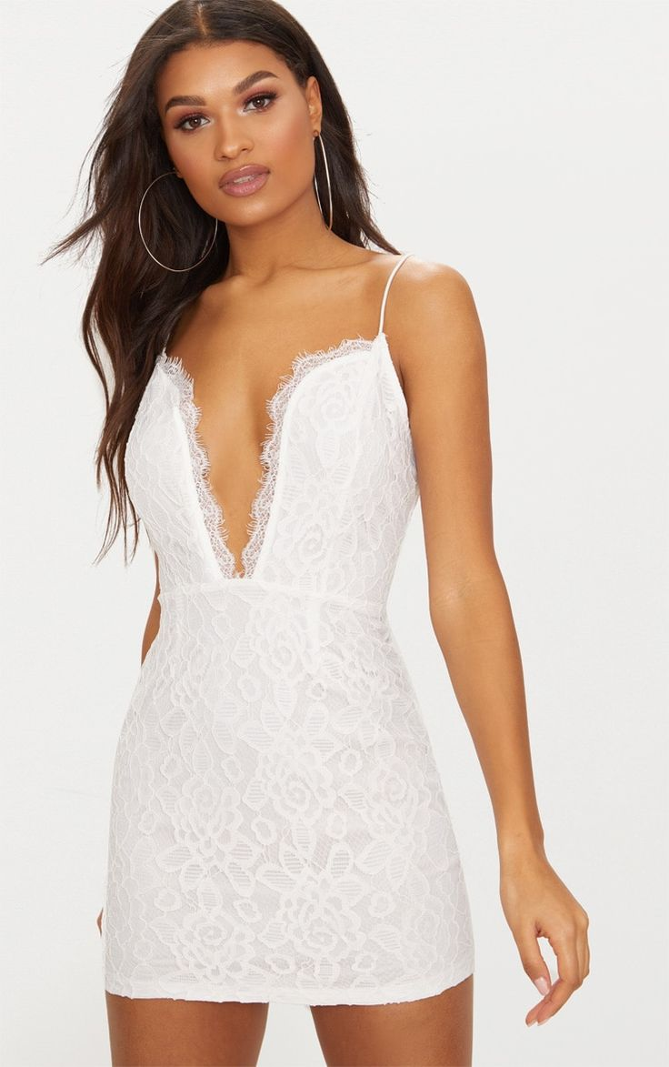 White Strappy Plunge Lace Bodycon DressLook feminine and fierce this weekend in this white mini d...