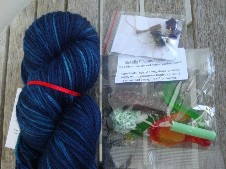 "Winter Yarn Club 2011 - July (Wizards and Witches) Boys Package includes: ""Wizards Spell"" yarn, Knitters Spell lolly mix, Witchy stitchmarkers by Tammy of ""Angel Inspired"" ""Dueling Wands"" pattern by Kelly Brooker and a 50% off voucher from Kelly. 