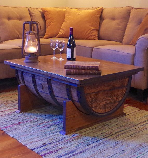 An authentic reclaimed oak barrel, with a hinged solid wood top. This hand finished piece meets rustic with class, and becomes its own