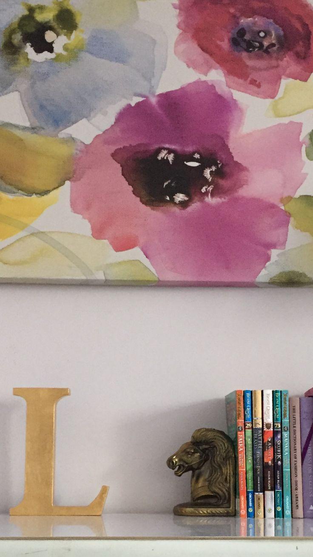 Girls room vignette Floral art Gold accents, lavender walls