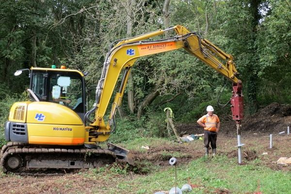 Screw piles being driven for the viewing platform in Hunt Nature Park, Shalford.