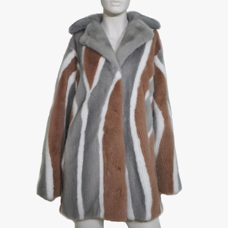 Earth colours like sapphire, white and tea rose combine into this beautiful mink fur coat.