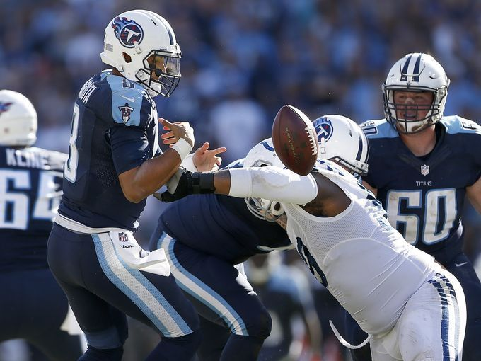 Colts vs. Titans  -  26-34, Colts:  October 23, 2016  -  Indianapolis Colts defensive tackle T.Y. McGill (99) strips the ball away and sacks Tennessee Titans quarterback Marcus Mariota (8) late in the fourth quarter of their game Sunday, October 23, 2016, at Nissan Stadium in Nashville TN.  The Colts defeated the Titans 34-26.