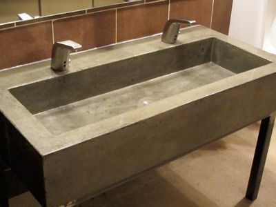 Modern gray concrete trough sink for restaurant bathroom in Denver CO
