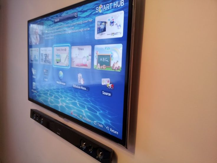 Samsung TV wall mounted with soundbar
