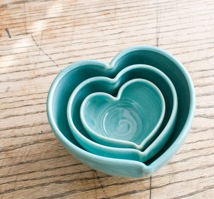 Cute-as-can-be heart-shaped nesting bowls.  For candy, candles, dip, nuts, what-have-you...