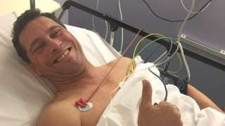 "Image copyright                  UKIP                  Image caption                                      The party released photos of Mr Woolfe in hospital on Thursday, when he said he was ""feeling brighter""                                UKIP MEP Steven Woolfe will be kept in hospital for a further 48 hours following an altercation with a colleague i"