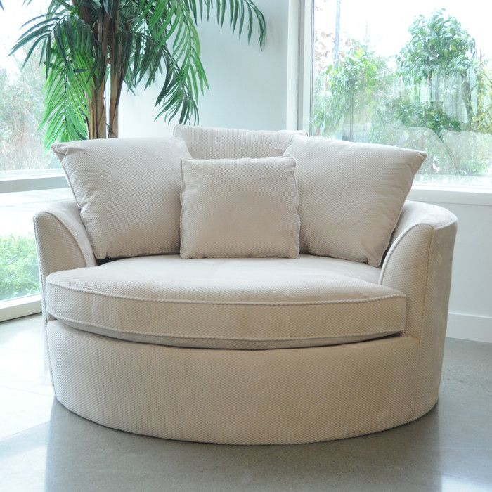 Create your own comfort zone with the Cuddler chair. This oversize round chair comfortably fits two people. Covered in a durable microfiber fabric for years of enjoyment. Make sure to measure before ordering.