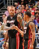 Chris Andersen and Shabazz Napier of the Miami Heat during the game against the Orlando Magic on February 25 2015 at Amway Center in Orlando Florida...