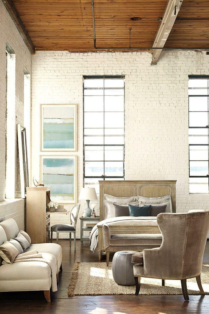 Neutral loft bedroom by designer William Peace