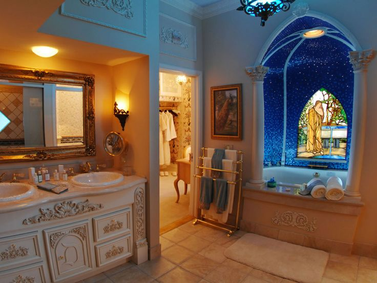 bathroom with luxury bathtub chandelier columns and stained glass window