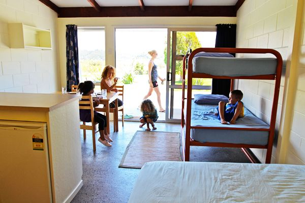 The Lodge   Russell - Orongo Bay Holiday Park  Our spacious Lodge rooms with kitchens accommodate up to four guests and are excellent value. The kitchens have a microwave, fridge, cook top or frypan, toaster, electric jug, cutlery and crockery.
