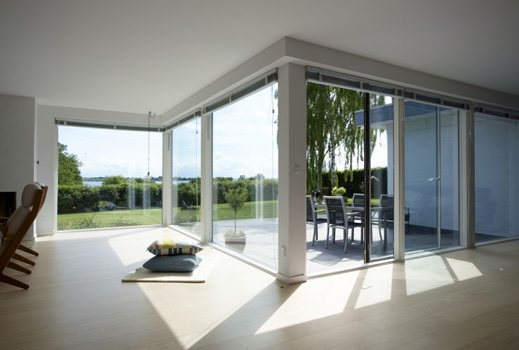 Renovated home with large modern VELFAC 200 windows and sliding doors.