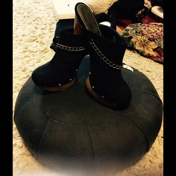 """Black Faux Suede Clogs Gorgeous """"Elle"""" clogs with a pewter chain going across the front of shoe. Pewter studs lining the sides of the shoes. 4.5' heels with a platform... Amazing with jeans... Elle Shoes Mules & Clogs"""