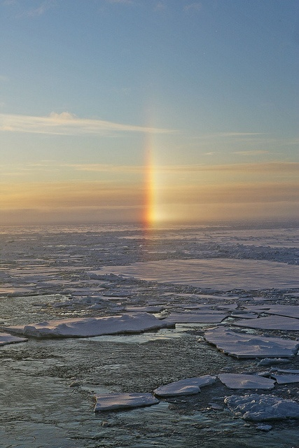 A sun dog - an atmosphere phenomenom caused by refraction of sunlight through ice crystals in the atmosphere. From the NOAA Photo Library. #NaturePhotography