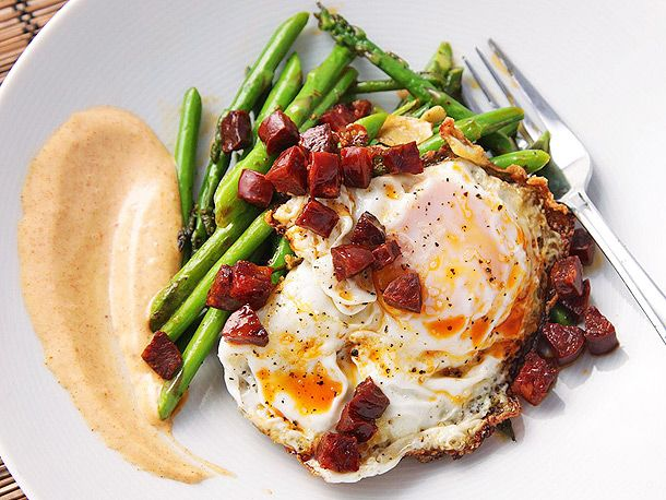 Perfect breakfast for dinner fare: Sauteed Asparagus with Chorizo, Fried Eggs, and Smoked Paprika Allioli #breakfast #recipe