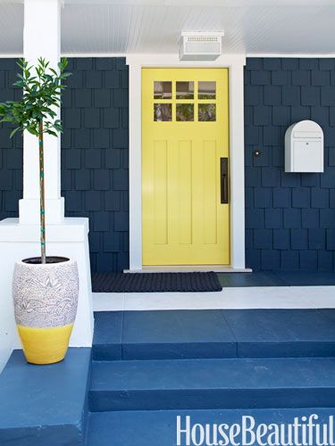 Navy blue house, yellow door and white trim