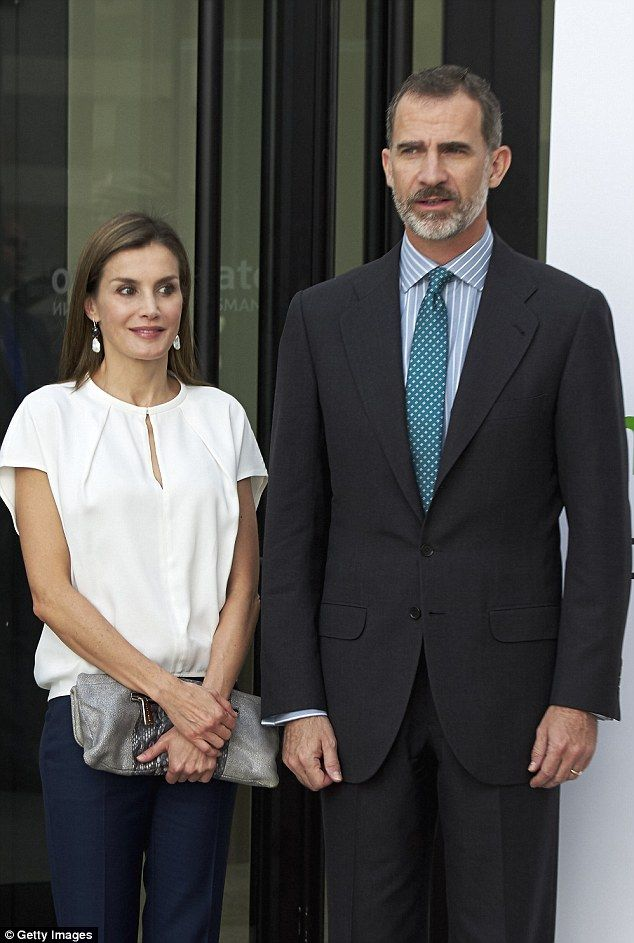 The Spanish Queen added interest to her understated outfit with a silver clutch bag...