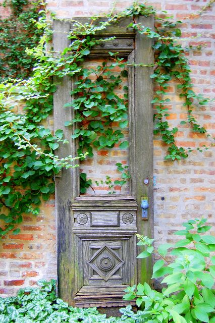 "Love a door in a garden! Maybe as another ""layer"" to block the view behind the fence?"