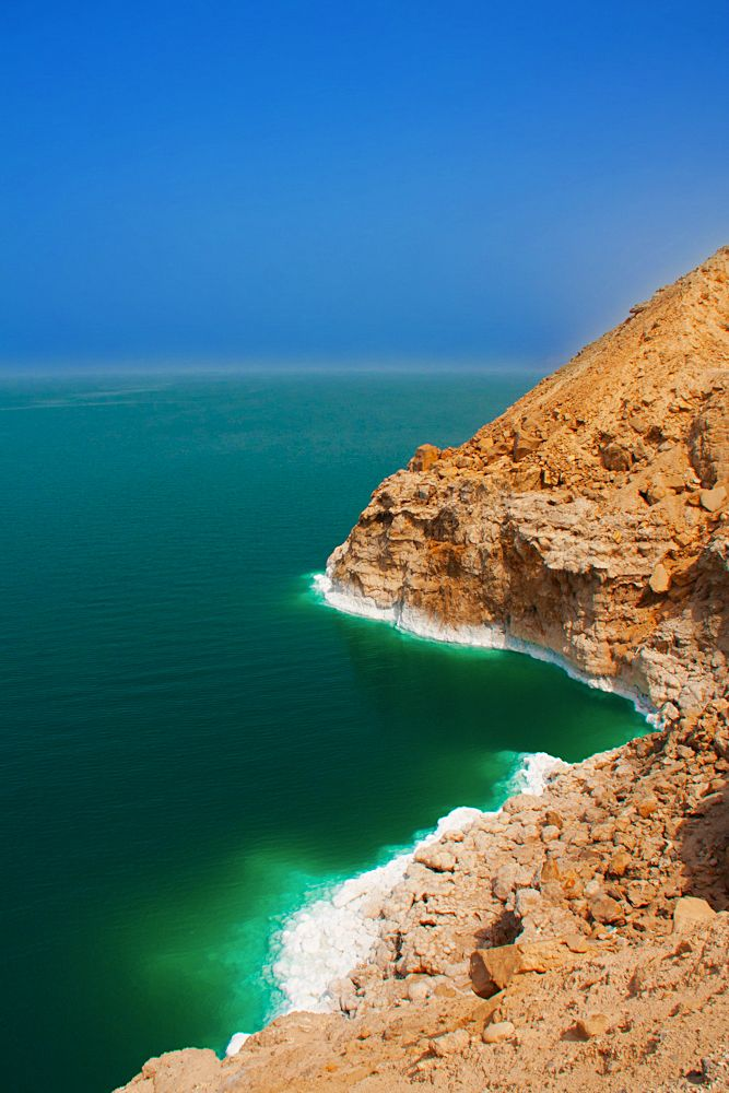 Jordan - Dead Sea. Facts about Jordan: Area: 89,206 sq km. Lies on the eastern bank of the Jordan River. Agriculture and population are concentrated near the river. Most of the country is desert. Population: 6,472,392. Capital: Amman. Official language: Arabic. Languages: 16