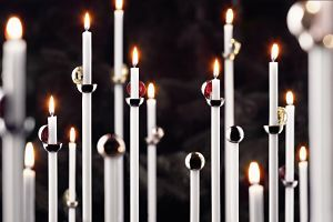 Scandinavian Christmas Candle Snuffers from Menu  http://www.ukhomeideas.co.uk/ideas/other/christmas-decorations/the-%E2%80%9Cscandinavian-christmas%E2%80%9D-theme-from-menu/#