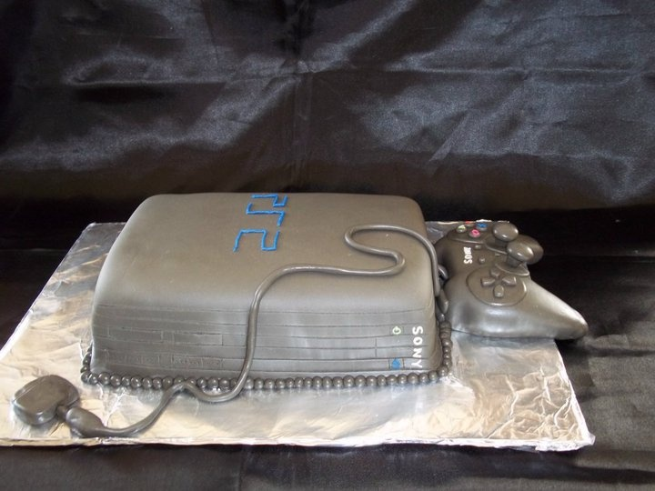 PS2 cake from Just That Occasion on Facebook, the controler is hand made of fondant!