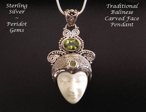 Face Bone Carving Artisan Crafted Sterling Silver - Superb Traditional Balinese Carved Bone Face Artisan hand crafted Sterling Silver Necklace Pendant featuring two Peridot Gemstones in an intricate detailed setting - a beautiful example of the wonderful skills of the Artisan Silversmith from Bali