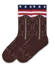 K Bell Womens American Made American Flag Boot Sock starts with a French Roast background. The Boot is Detailed with a Cream White Stitching of a Western Cowboy Boot. Next as if sticking out of the boot is the American Flag some bars in Red and White and on the Row of Blue are White Five pointed Stars.