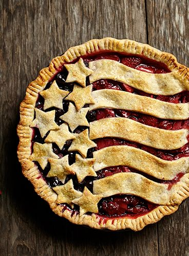 Fresh summer berries and a flaky butter almond pie crust create a perfect pie for the Fourth of July.
