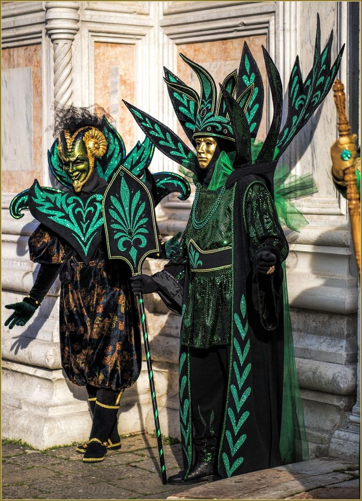 scary in costumes of greens and black at Carnival of Venice 2016