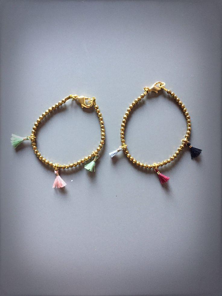 Bracciali dorati con ematite dorata e nappine piccole multicolor di LesJoliesDePanPan su Etsy