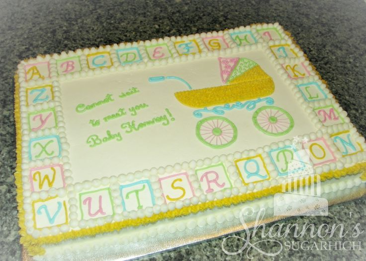 Lemon sheet cake with vanilla buttercream in white, blue, pink, yellow, and green for a gender neutral baby shower. Keywords: carriage, alphabet.