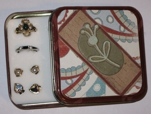 upcycled tin.  from trash to travel case for rings and earrings.
