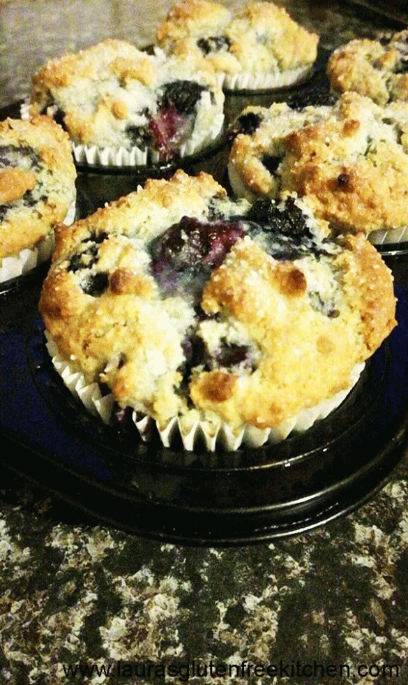 These Gluten Free Bakery Style Blueberry Muffins are soft, fluffy, and full of juicy blueberry goodness. They are finished with a sweet sprinkle of sugar on a super high muffin top