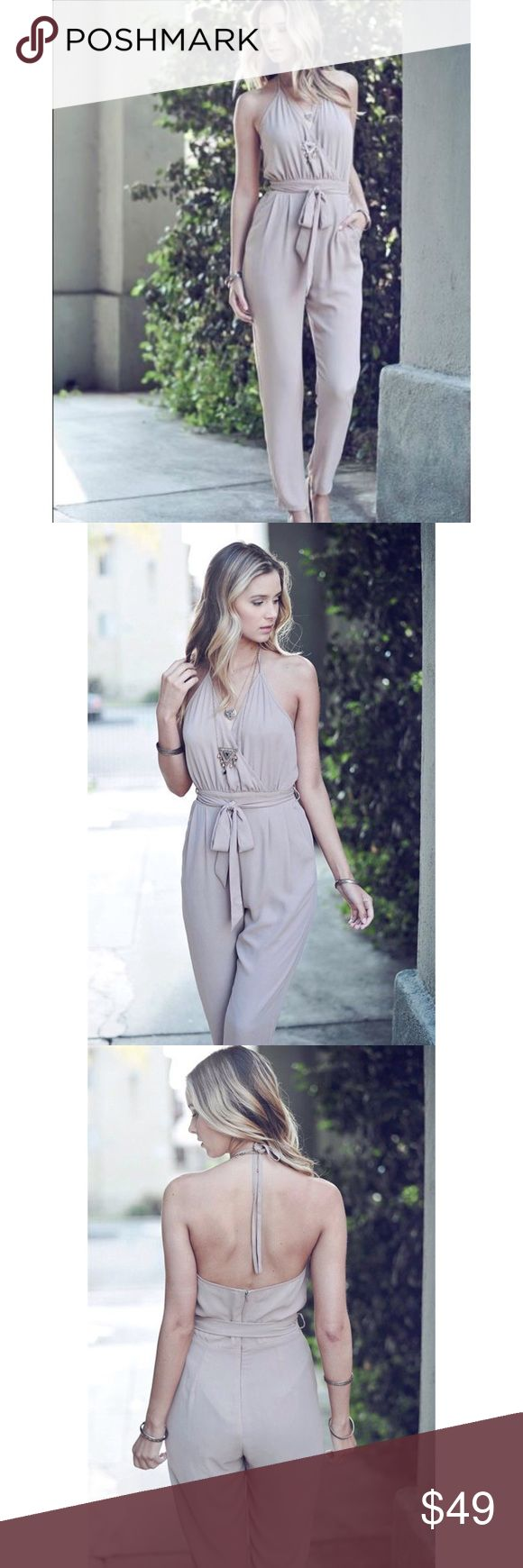 "(S,M,L) One Piece Halter Tie Jumpsuit  A chic jumpsuit for when you need a quick outfit   Halter tie with surplice top and waist tie make it easily adjustable  Self/Lining 100% Polyester  Hand wash cold, line dry  Approximate Measurements   SMALL  Bust: 32"" Waist: 26"" Inseam: 29"" Leg Opening: 11""  MEDIUM  Bust: 36"" Waist: 28"" Inseam: 29"" Leg Opening: 12""  LARGE  Bust: 38"" Waist: 30"" Inseam: 29"" Leg Opening: 13"" Double Zero Pants Jumpsuits & Rompers"