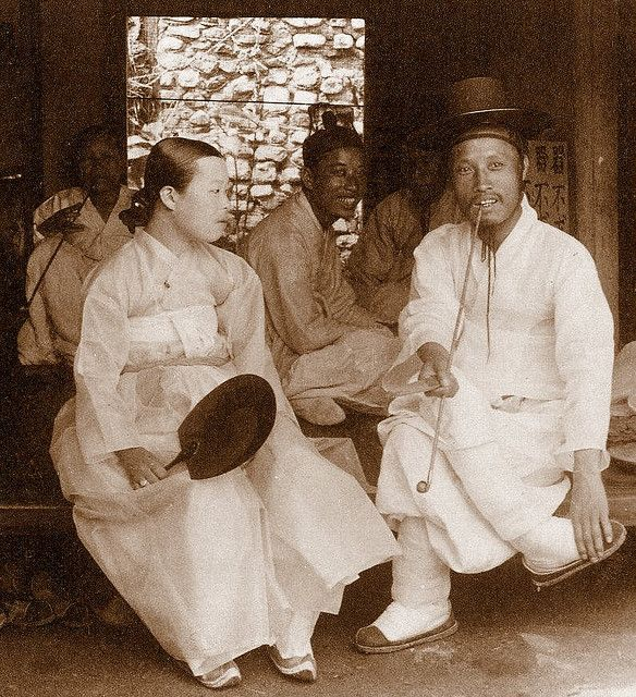OLD KOREA - LAND OF THE MORNING CALM -- A Happy Couple Visiting Relatives in SEOUL, 1903  Photo by HERBERT G. PONTING, 1903.